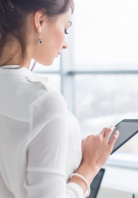 Photo of person reading email on tablet
